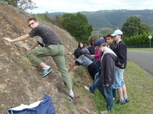 Students inspect an outcrop of Ashfield Shale
