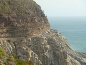 Chapman's Peak Drive south of Cape Town, South Africa. Road sits on grey granite pluton. Sedimentary strata sit alongside and above the road.