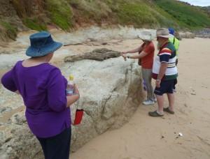 Inspecting granite outcrop at Phillip Island, Victoria.