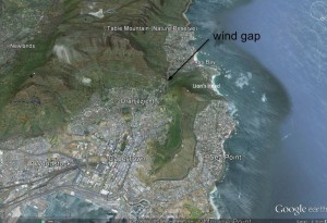 Figure 1. Looking south over Cape Town toward Table Mountain with Lions Head to the right. An incised channel forming a wind gap runs from Cape Town to the south-west. Image from Google Earth.