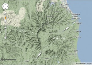 Figure 2. The landscape around Mt Warning, northern New South Wales (from Google maps). Arrows show area of escarpment that has been eroded away, and the direction that the receding waters of Noah's Flood flowed.